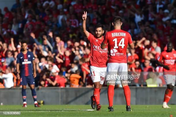 Tegi Savanier of Nimes celebrates his goal with Antonin Bobichon during the Ligue 1 match between Nimes and Paris Saint Germain on September 1 2018...