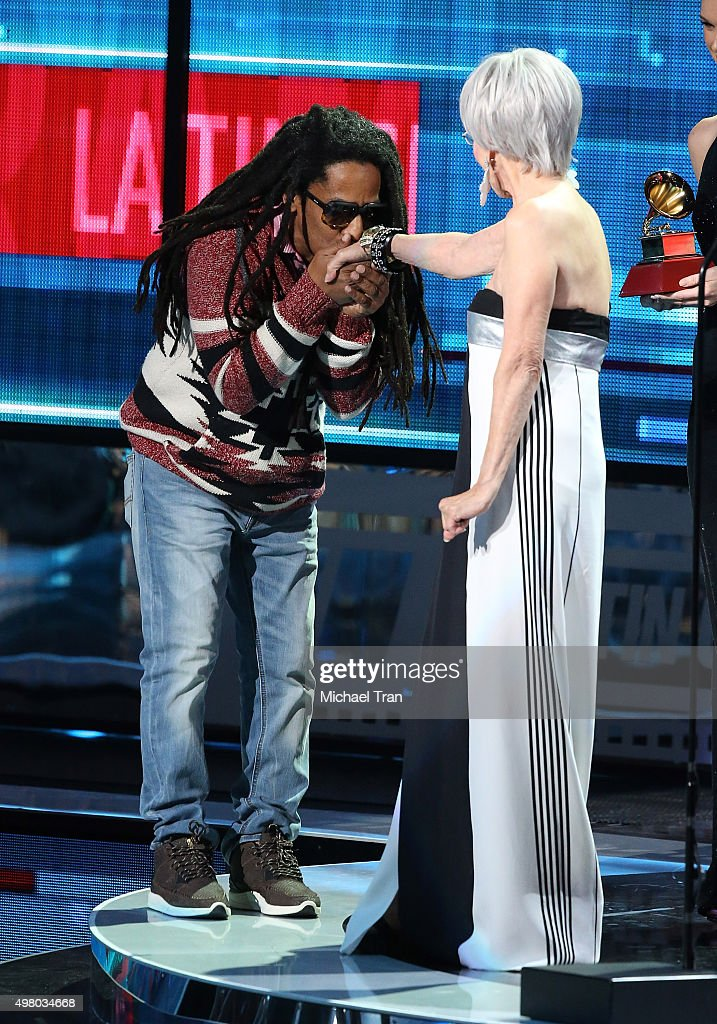 Tego Calderon accepts the Best Urban Music Album Grammy from Rita Moreno onstage during the 16th Annual Latin GRAMMY Awards held at MGM Grand Garden Arena on November 19, 2015 in Las Vegas, Nevada.