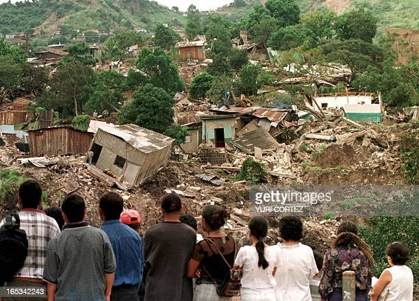 Tegucigalapa residents look at some of the homes destroyed by a mudslide on Cerro El Berrinche 03 de November The mudslide was triggered by heavy...
