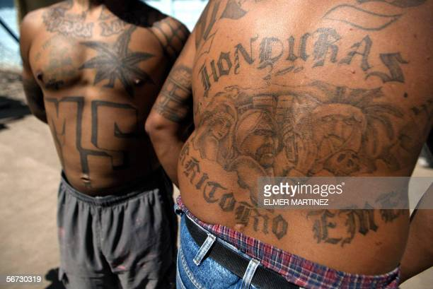 Two unidentified members of the Mara Salvatrucha MS13 show their tatoos in the unit where they are kept imprisioned in the National Penitentiary in...