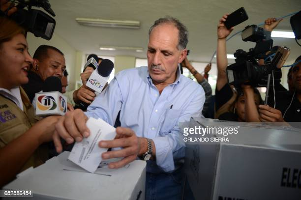 Tegucigalpa's mayor Nasry Juan Asfura Zablah of the Partido Nacional ruling party votes during the primary election in Tegucigalpa on March 12 2017 ^...