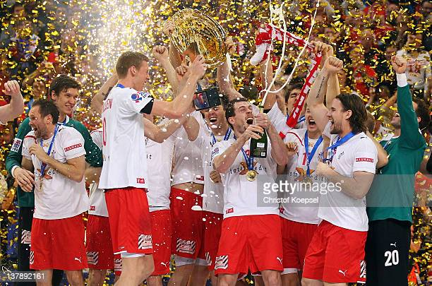Teh team of Denmark celebrates with the EHFR tropy after winning 21-19 the Men's European Handball Championship final match between Serbia and...
