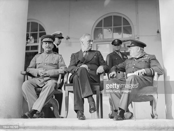 Winston Churchill Franklin D Roosevelt And Joseph Stalin Meet In Iran Joseph Stalin Franklin D Roosevelt and Winston Churchill sit on chairs on the...