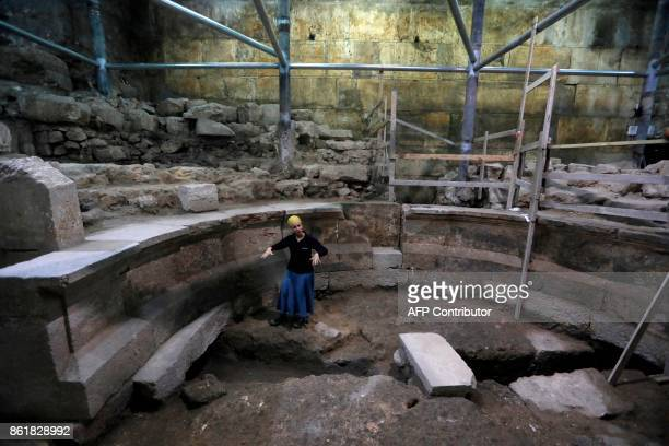 Tehillah Lieberman an archeologist of the Israeli Antiquity Authority shows journalists a recently discovered ancient roman theatre from the second...
