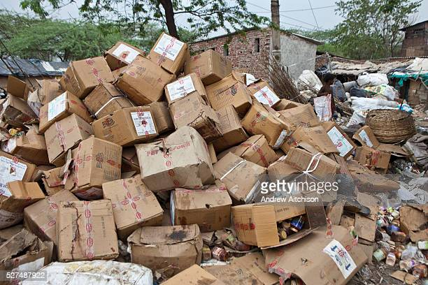 Tehkhand Slum Delhi India Cardboard boxes of out of date food collected from the streets and rubbish tips to sell to local dealers Many slum dwellers...