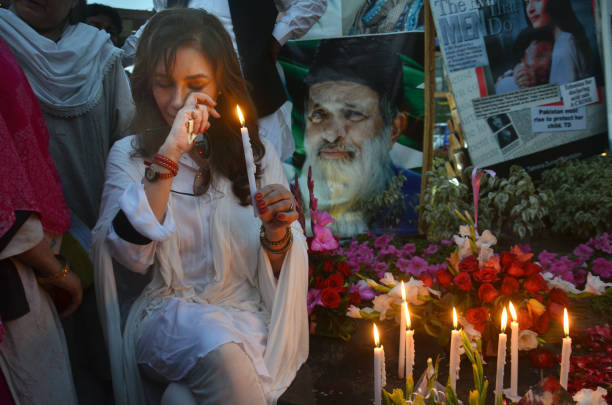 Tehmina Durrani a social activist and wife of Punjab Chief Minister lighting candles during a vigil in memory of Abdul Sattar Edhi and victims of...