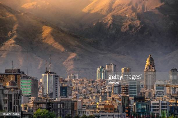 tehran cityscape from tabiat bridge against alborz mountain, iran - tehran stock pictures, royalty-free photos & images