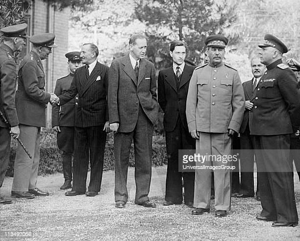 Tehran Conference Iran 28 Nov1 Dec 1943 Scene outside Russian Embassy with centre Roosevelt's adviser Harry Hopkis Stalin's interpreter Stalin...