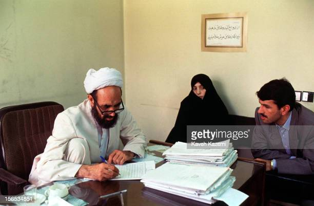 Clergy judge examines the case of a young couple wishing to divorce due to the husband taking a second wife. In Iran, most administrative offices...