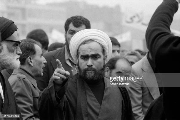 A clergyman pointing his finger towards the crowd seen among demonstrators during the Iranian Revolution on 19th January 1979