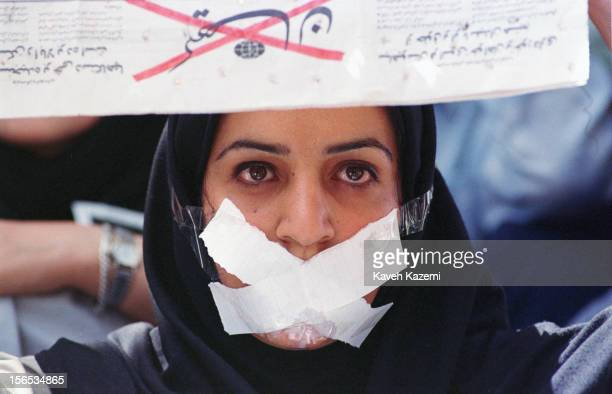 A female student demonstrates against censorship at Tehran university after reformist newspapers were closed down She holds a copy of the newspaper...