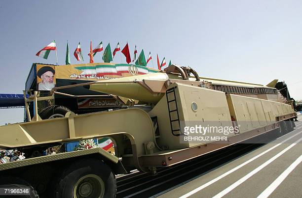 A military truck carries a longrange Iranian Shahab3 Ballistic missile as it passes by a portrait of Iran's late founder of Islamic Republic...