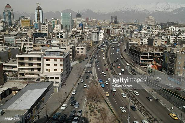 Aerial view of Tehran against the backdrop of mountains towards the north of the capital, bisected by the Modaress highway. Many high-rise buildings...