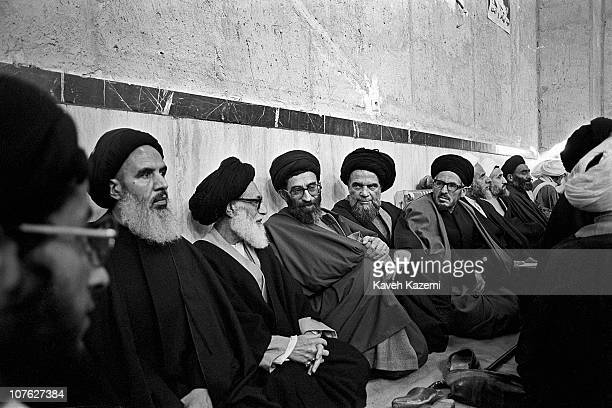 Ali Khamenei, president of Iran , sits amongst clergymen in Jamaran mosque during an audience with Ayatollah Khomeini, 1st March 1982.
