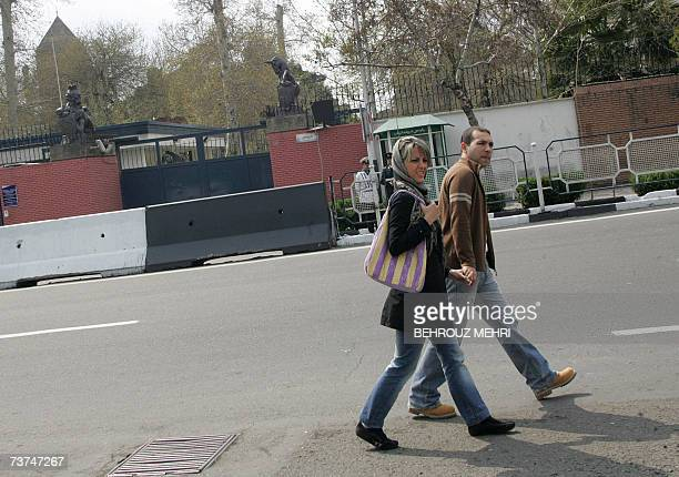 An Iranian couple walks past the British Embassy in Tehran 30 March 2007 British Prime Minister Tony Blair said today that Britain wanted Iran to be...