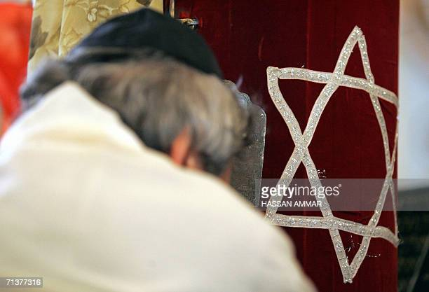 An Iranian Jew wearing a prayer shawl performs the Morning Prayer ritual at a Tehran synagogue 06 July 2006 According to the president of Tehran's...