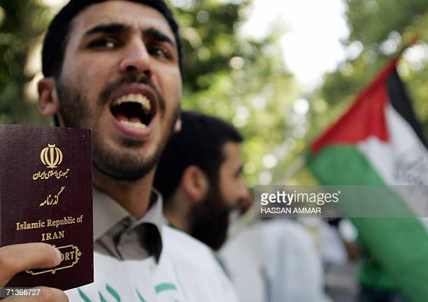 An Iranian man holds up his passport and chants antiUS and antiIsrael slogans during a demonstration in Tehran 04 July 2006 A group of around 50...