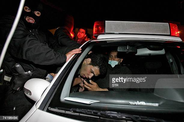 An Iranian policeman arrests a man during a morality crackdown in Tehran 18 May 2007 Iran's police have arrested more than 1000 'thugs' in a new...