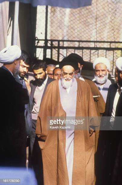 Ayatollah Ruhollah Khomeini the leader and founder of Islamic Republic of Iran looking frail surrounded by members of staff in his residence in...