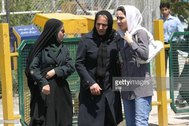 CORRECTING CITY IN IPTC An Iranian policewoman warns a young woman about her clothing and hair during a crackdown to enforce Islamic dress code in...