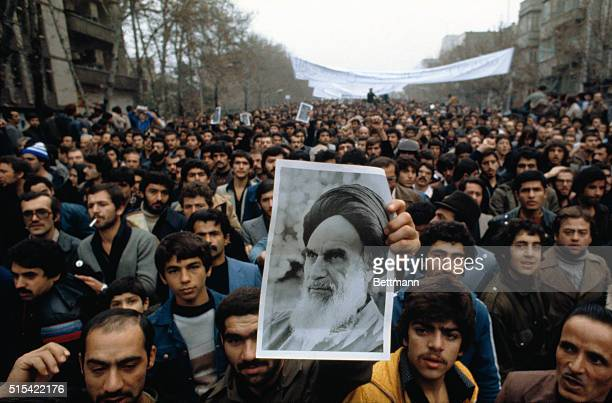 Demonstrators carry photo of Ayatollah Khomeini during antishah demonstration