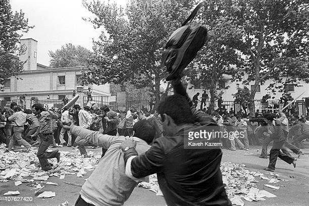 Hezbollah forces attack leftist students in street clashes outside Tehran university campus on the occasion of Cultural Revolution 21st April 1981...