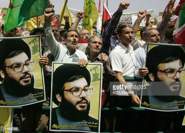 Iranian demonstrators hold up posters of Lebanese Hezbollah chief Hassan Nasrallah during a protest in Tehran 18 July 2006 against Israel's military...