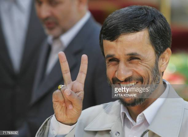 Iranian President Mahmoud Ahmadinejad flashes the Vsign for victory before a welcoming his Djiboutian counterpart Ismail Umar Guelleh in Tehran 03...