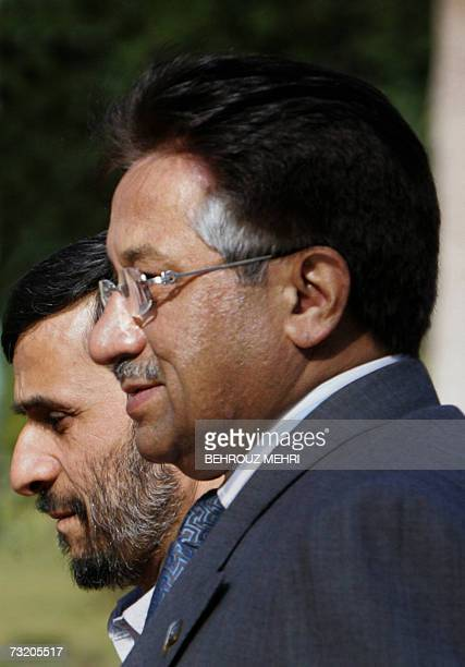 Iranian President Mahmoud Ahmadinejad walks with his Pakistani counterpart Pervez Musharraf during his welcoming ceremony in Tehran 05 February 2007...