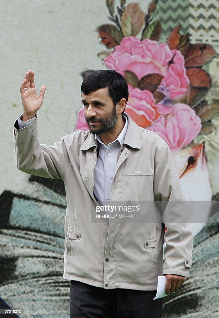 Iranian President Mahmoud Ahmadinejad waves during the inauguration ceremony of Tehran's 19th International Book Fair 03 May 2006. A senior Iranian military official warned 02 May 2006 that the Islamic republic would target Israel if it came under US attack over its nuclear programme. In early April, Iran, whose hardline president has called for Israel to be wiped off the map, launched a military maneuver used as much to rally support on the domestic front as to send a message to critics of its controversial nuclear programme.
