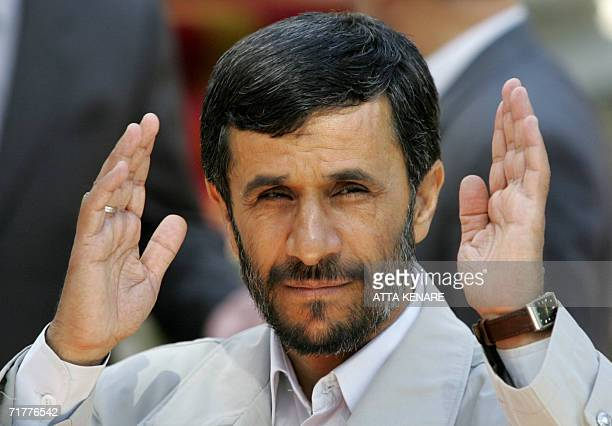 Iranian President Mahmoud Ahmadinejad waves to the media before a welcoming ceremony for his Djiboutian counterpart Ismail Umar Guelleh in Tehran 03...