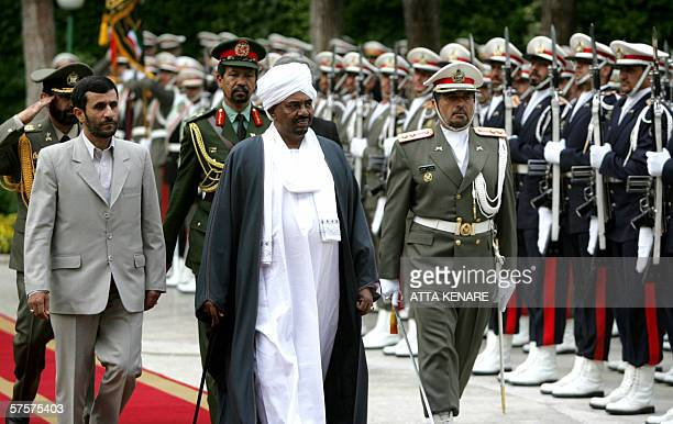 Iranian president Mahmud Ahmadinejad and his Sudanese counterpart Omar alBashir review an honour guard upon the latter's arrival in Tehran on an...