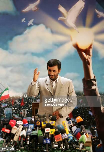 Iranian President Mahmud Ahmadinejad gestures to journalists during a press conference in Tehran 24 April 2006 Ahmadinejad dismissed a UN Security...