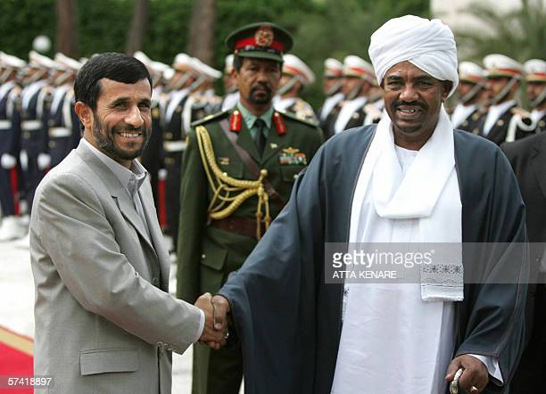 Iranian president Mahmud Ahmadinejad shakes hands with the Sudanese President Omar alBashir upon the latter's arrival in Tehran on an official visit...