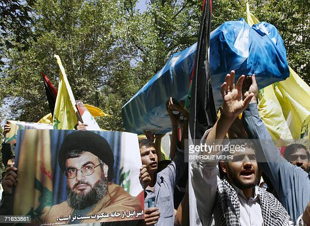 Iranian students carrying a symbolic coffin wrapped with a United Nations falg and holding up a portrait of Lebanese Hezbollah leader party Hassan...
