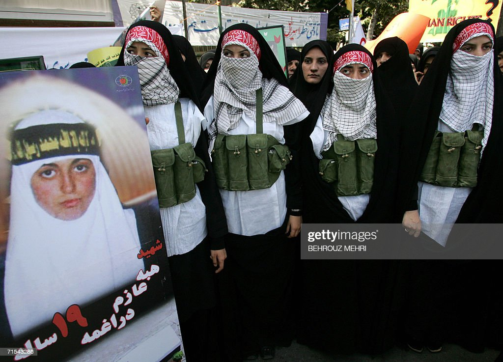 Iranian women dressed as suicide bombers : News Photo