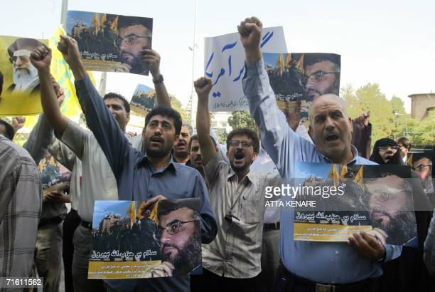 Iranians hold up portraits of Lebanese Hezbollah leader Hassan Nasrallah during a demonstration to show support for the Shiite leader 09 August 2006...