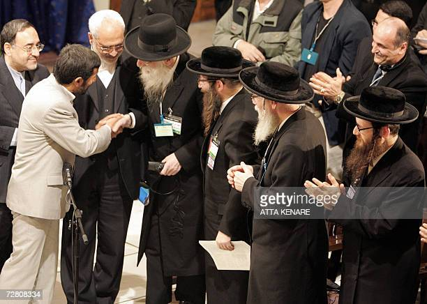 Members of Naturei Karta shake hands with Iranian President Mahmoud Ahmedinajad before speaking during a controversial conference aimed at breaking...