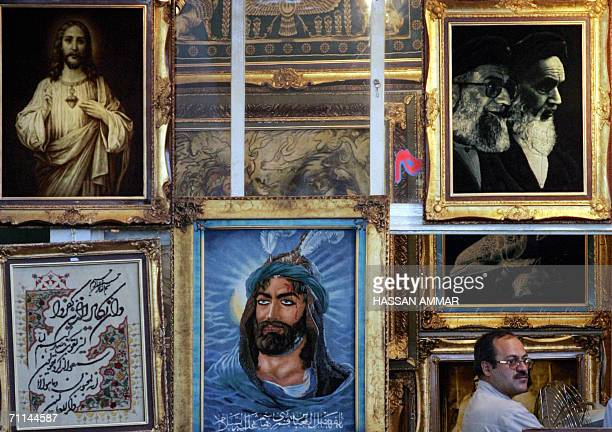 Portraits of Abu AlFadl AlAbbas the son of revered Imam Ali who was killed in Karbala Jesus Christ and Imams Khomeini and Khamenei are displayed at a...