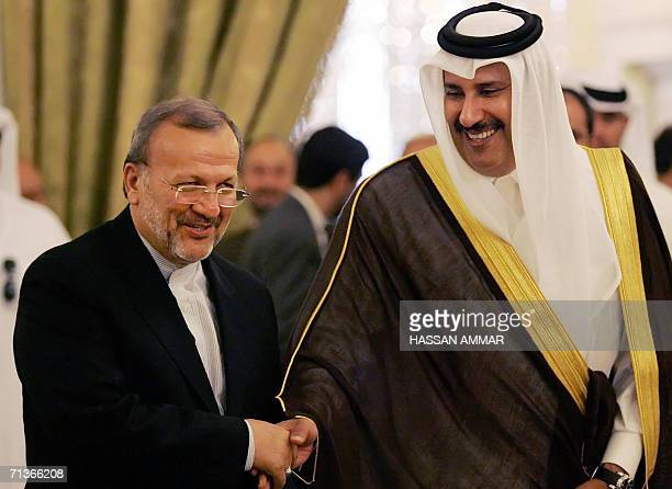 Qatar's Deputy Premier and Foreign Minister Sheikh Hamad bin Jassim bin Jabor alThani shakes hands with Iran's Foreign Minister Manouchehr Mottaki in...