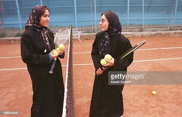Tennis champions practice in a women's tennis court in Tehran. Women's bodies must be covered while doing sports and mixing with men on playgrounds...