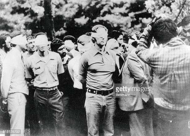 Tehran, Iran. This photo taken on the first day of occupation of the U.S. Embassy in Tehran shows American hostages being paraded by their militant...