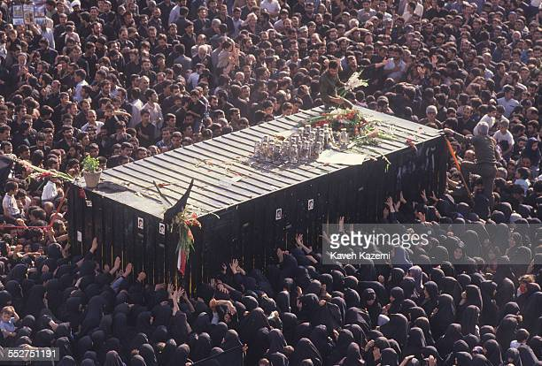 Thousands of people gather around a container holding the body of Ayatollah Khomeini, in his final resting place near Behesht Zahra cemetery in...