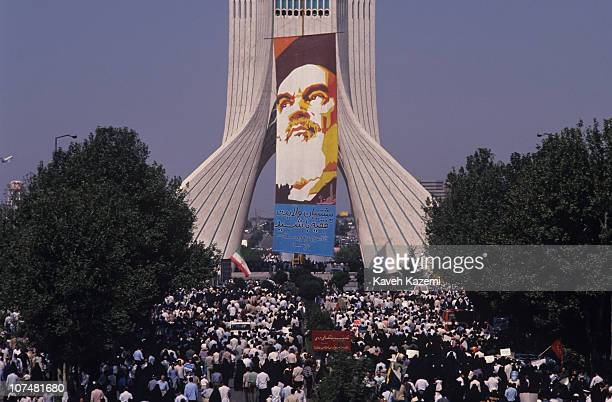 Thousands of people participate in a Tehran rally marching towards Azadi square upon a call by the government to show their unity with Ayatollah...