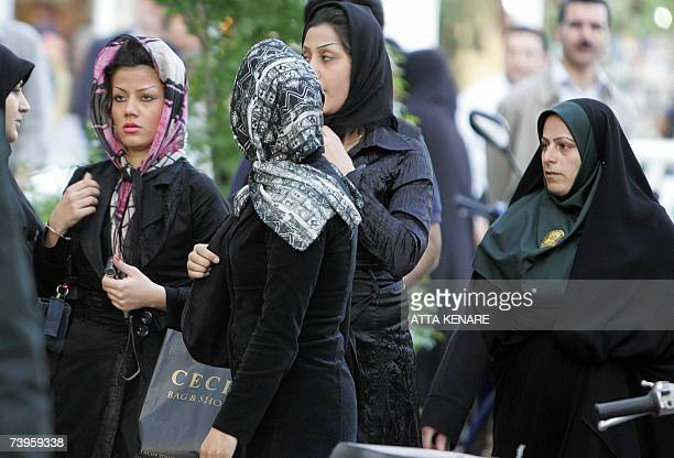 TO GO WITH AFP STORY BY FARHAD POULADI An Iranian policewoman warns women about their clothing and hair during a crackdown to enforce Islamic dress...