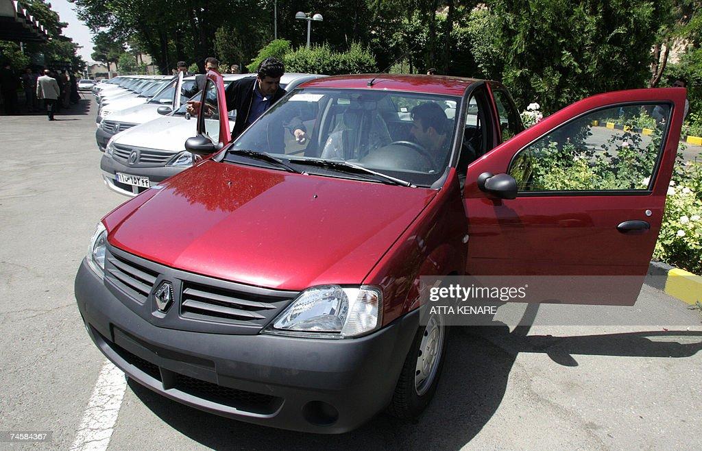 Two Iranian men enter their Renault's Lo... : News Photo