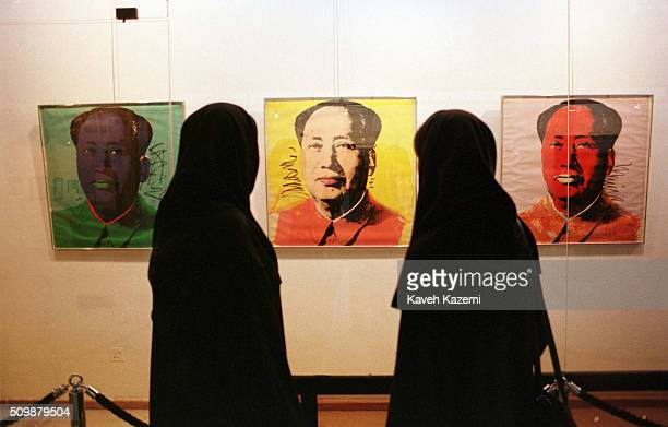 Veiled visitors viewing American Artist Andy Warhol art on Mao Tsetung on display at the Tehran Museum of Contemporary Art 23rd September 1999 Much...