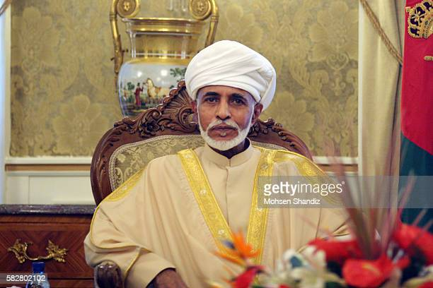 Iranian President Hassan Rowhani poses for a picture with Oman's Sultan Qaboos bin Said during the latter's welcoming ceremony at Tehran's Saadabad...