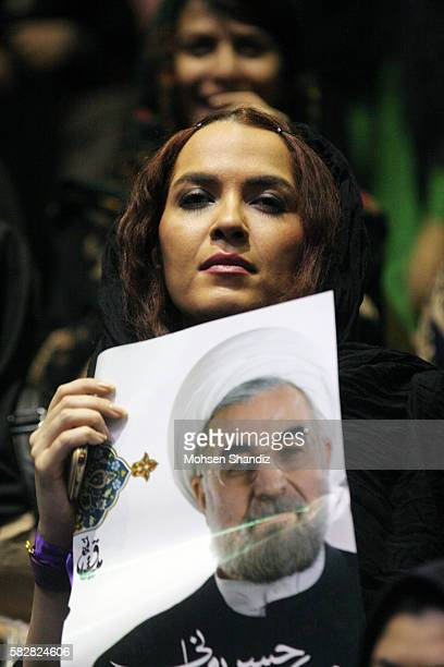 Iranian supporters of Hassan Rowhani a moderate Iranian presidential candidate and former top nuclear negotiator hold his portrait during a campaign...