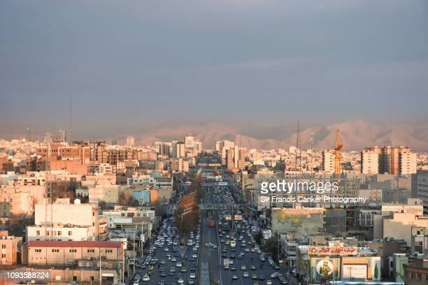 "tehran skyline with prominent ""azadi street"" as seen from azadi tower in iran - tehran stock pictures, royalty-free photos & images"